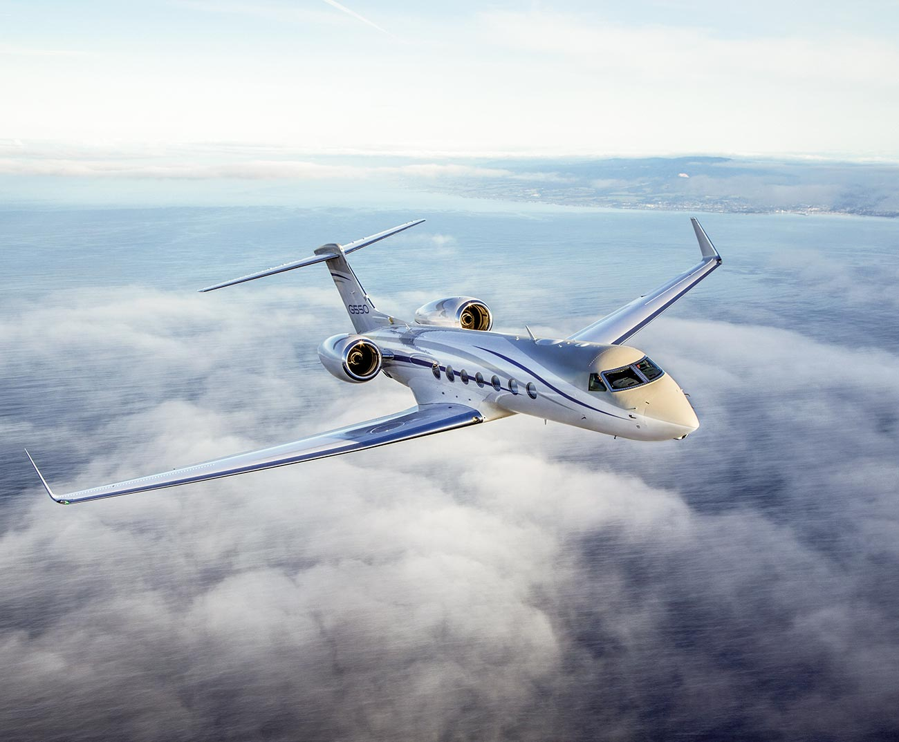 G550 flying over clouds