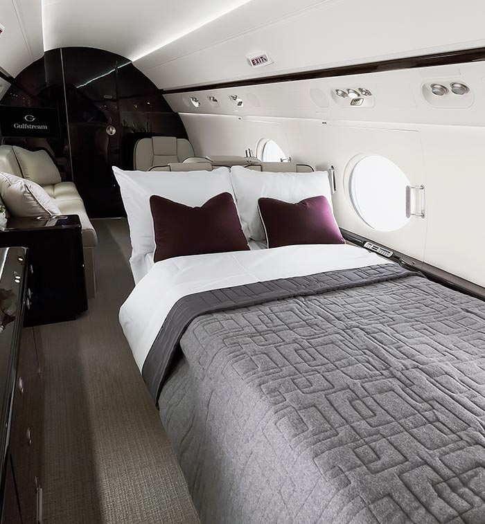 A bed shown inside a private jet cabin
