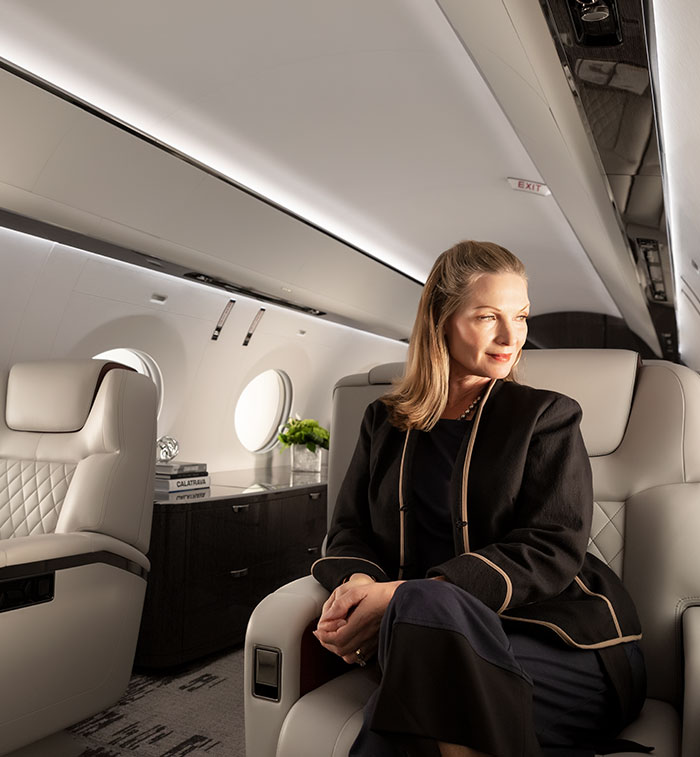 Woman seated inside aircraft