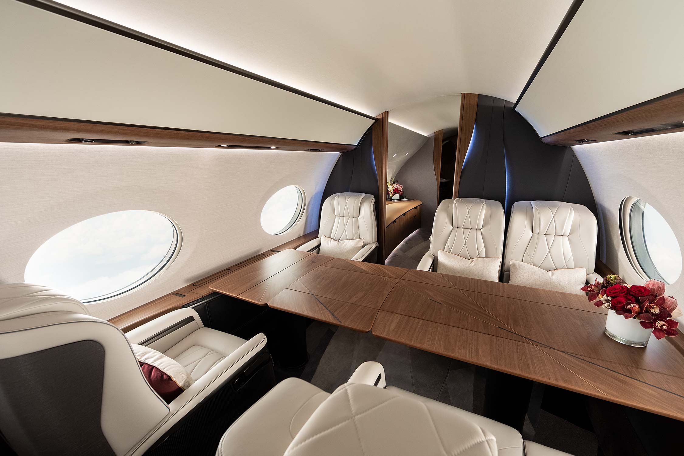 Conference table with six leather seats in a private airplane