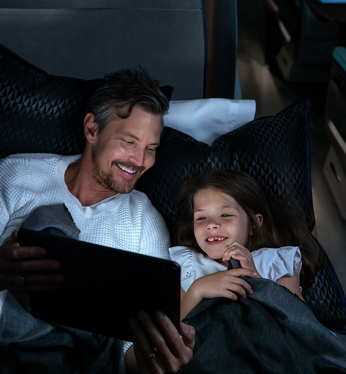 Father and Daughter watching tablet at night