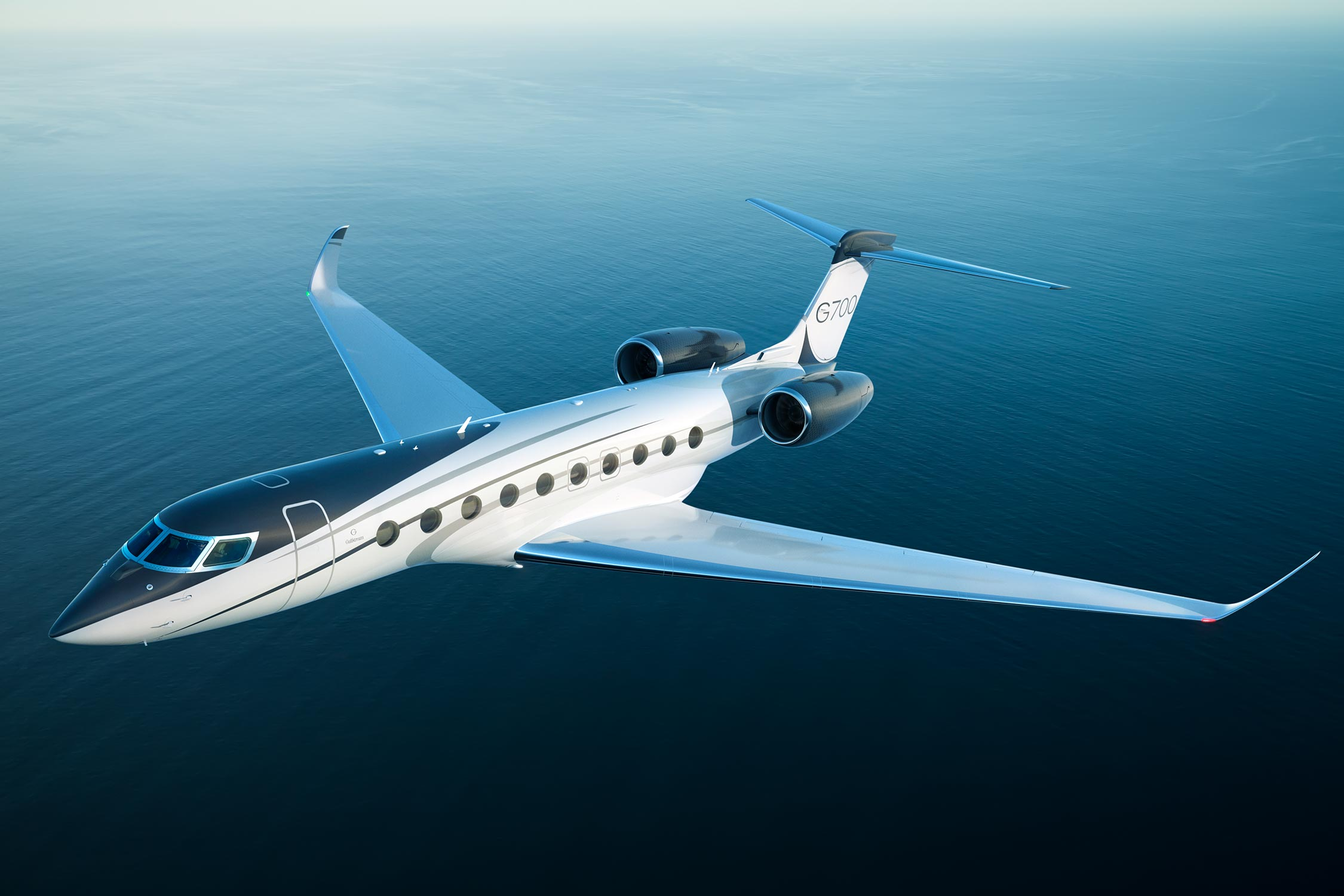 G700 flying over blue water