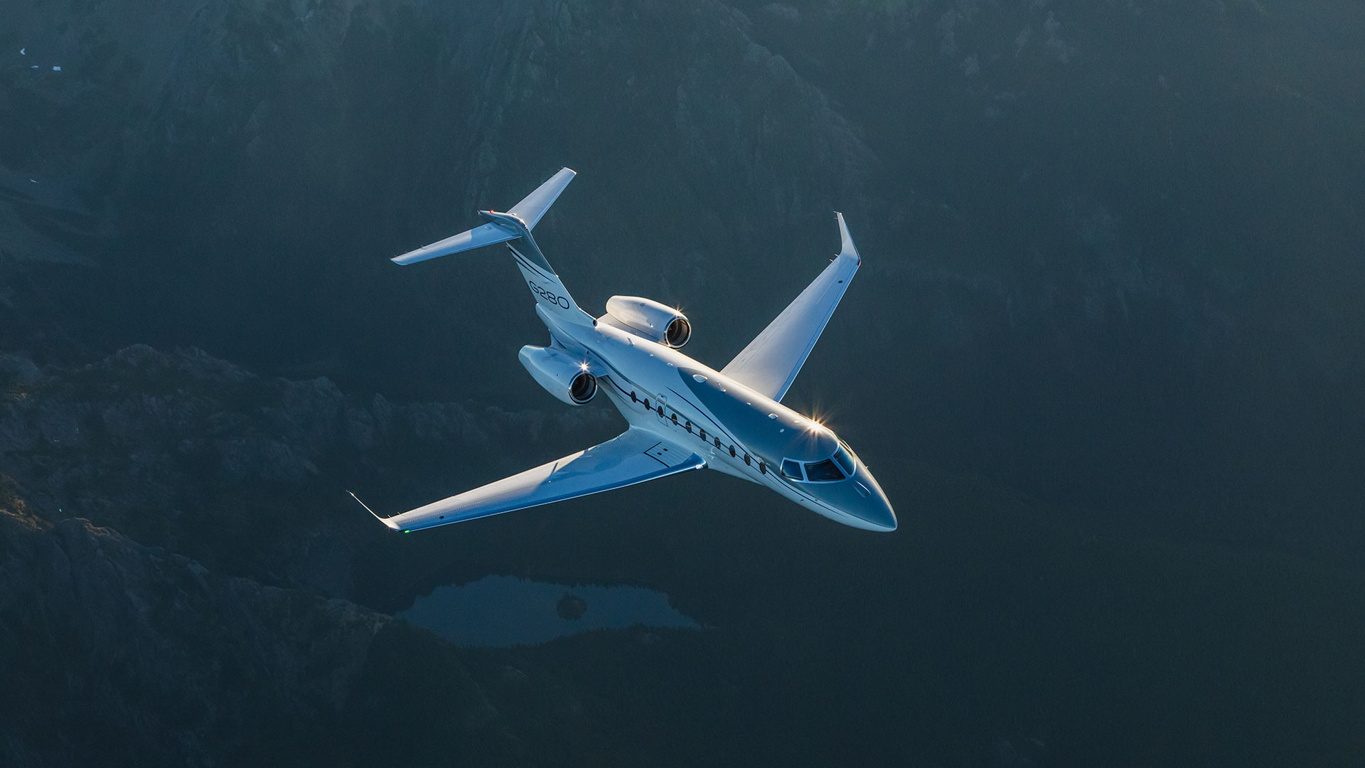 G280 flying over mountains