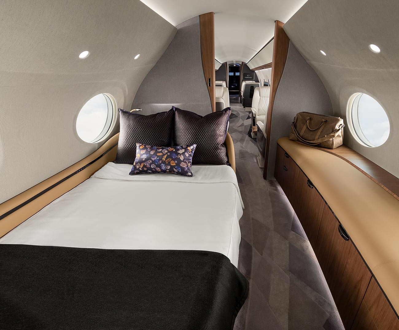 View of bed and dresser in luxury aircraft